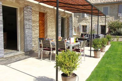 The shady pergola with garden furniture