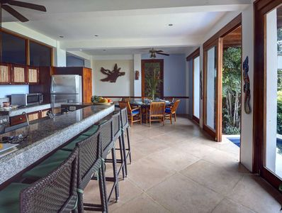 Kitchen with breakfast bar and dining room has an amazing ocean view
