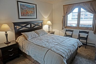 Queen Bed and 2 Chairs for Extra Sitting Space