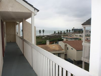 Photo for Quiet Beautiful Beach Condo steps to beach, We are the best deal!