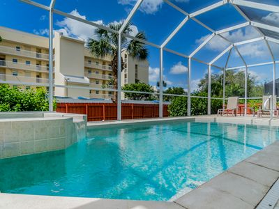 Photo for Sophisticated 3BR/2BA w/ Private Screened Pool & Hot Tub -- Blocks to Beach