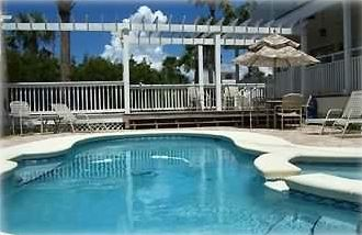 Heated tradewinds gunite Pool & Spa w/ brick sundeck