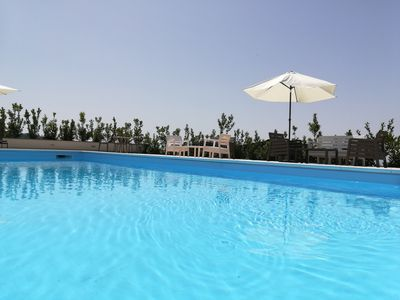 Photo for panoramic villa with heated swimming pool and riding school located in the park of Etna
