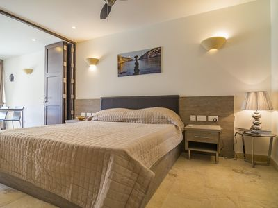 Photo for Seafront apartment in the quaint seaside village of Xlendi