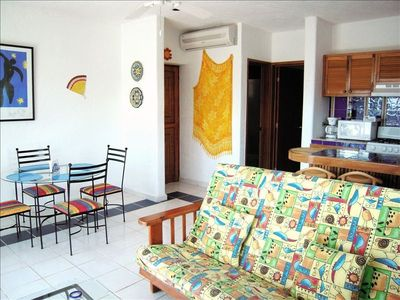 Breezy living room, dining area,  and traditional tiled kitchen, fully equipped