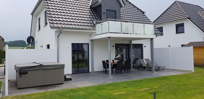 Photo for Villa Dalu am See with outdoor whirlpool, Sky TV, fireplace, sauna, near the lake 100 meters