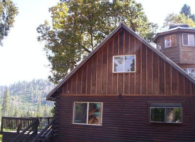 Side view of log home, deck, and cupola look out tower