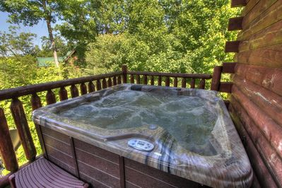 Hot Tub lower deck overlooking mountain view new in April 2014