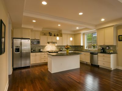 Gourmet kitchen with stainless appliances, granite countertops