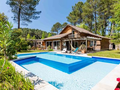 Photo for Wooden villa with heated pool