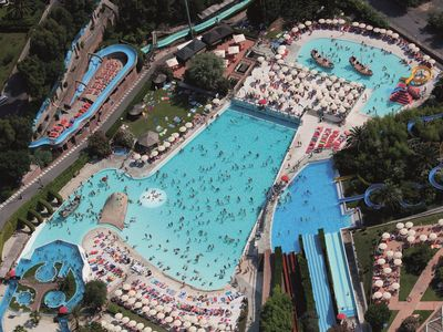 Photo for Bungalow with air conditioning in resort Il Paese di Ciribì