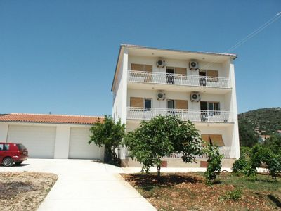 Photo for Two bedroom apartment with balcony and sea view Vinišće (Trogir)