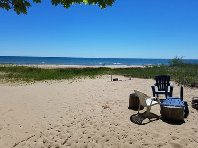 It doesn't get any better than this. Deep, private lot  120 ft. of sandy beach.