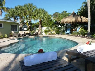 Photo for Tropical-themed getaway with a private pool - walk to free trolley, shopping!