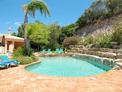 Photo for This 5-bedroom villa for up to 9 guests is located in Portimao and has a private swimming pool and W