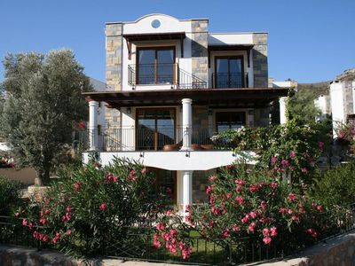 Photo for Stunning Torba Bay, luxury villa with shared pool, sea views, 8 mins walk to bea