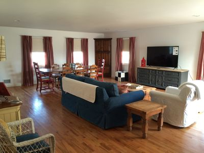 """Great room with 60"""" Smart TV, table seating for 10, and queen sofa bed"""