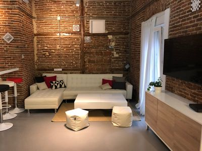 Photo for Red Brick Loft sleeps 6-8 Heart of Madrid