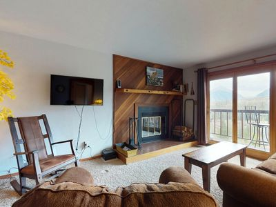 Photo for Mountain view condo w/ a private balcony, shared pool, & hot tub - near skiing