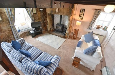 Photo for Characterful, dog friendly cottage, sea views, parking, 10 mins to the  beach