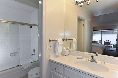Vanity Area with tub and shower