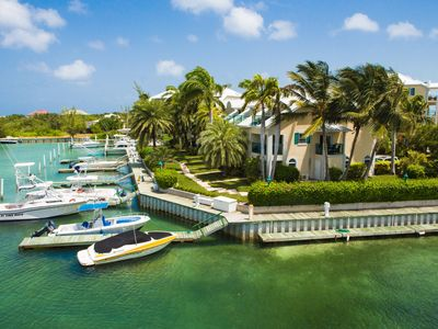 Photo for Spectacular Marina & Sunset Views, Suite & Private Terrace Right on Turtle Cove
