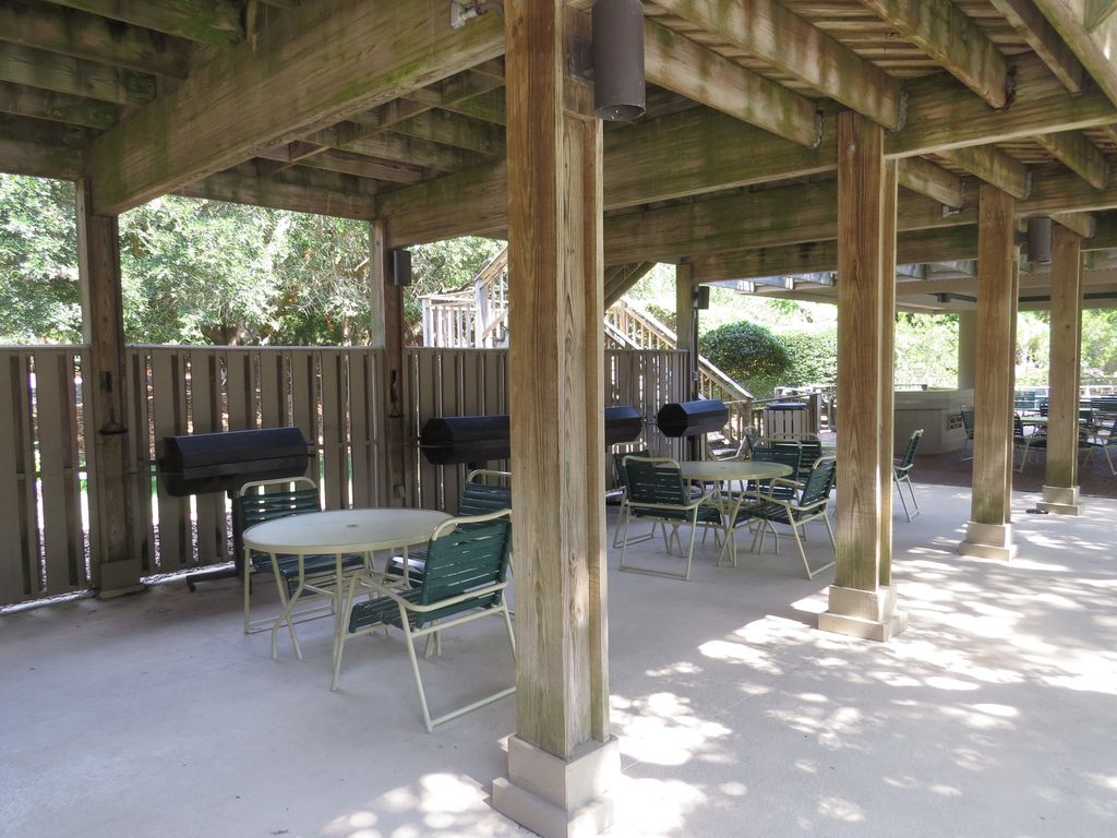 Isle of Palms condo rental   Outdoor grilling picnic area next to Ocean  Club pool. Stunning oceanfront condo   Contemporary Oceanfront Wild Dunes