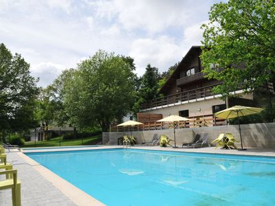 Photo for Modern luxury chalet with a private wellness area and shared outdoor pool