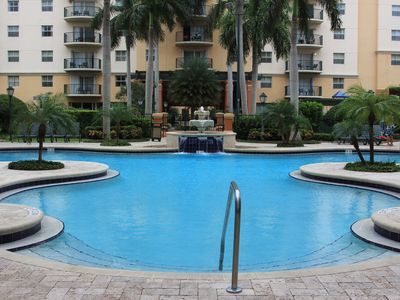 Photo for Beautiful resort with wonderful outdoor amenities including shuttle to beach!