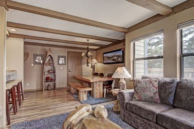 Spacious open floor plan with lovely mountain decor and many complex amenities.
