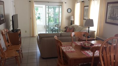Open concept dining/living room that open on to a three  season enclosed porch.