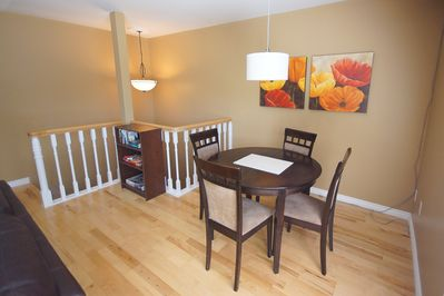 There are two additional chairs and a leaf to expand the dining table.