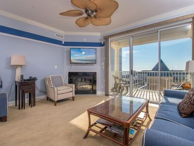 Photo for Luxury condo located right on the boardwalk, out outdoor pool.  Park your car until you leave to go home!