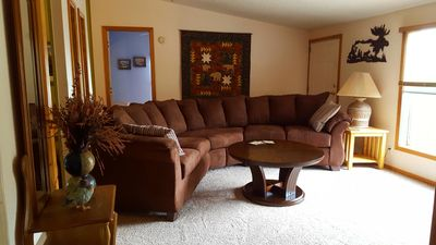 Newly decorated living room (summer 2017) features cozy seating and woodsy décor