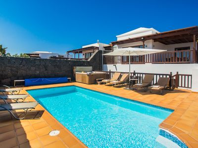 Photo for Lovely spacious villa with heated pool, jacuzzi, sea/mountain views, full aircon
