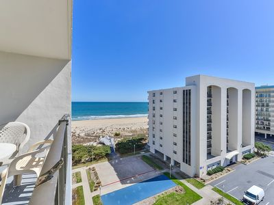 Photo for Stylish, cozy 2 bedroom oceanfront condo with free WiFi, an outdoor pool, a tennis court, and a great side view of the ocean just steps from the beach and located uptown!