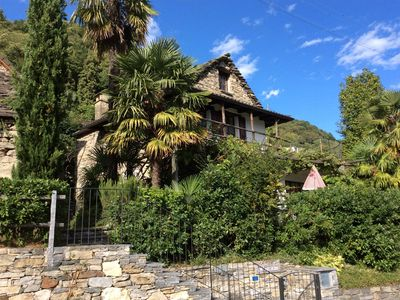 Photo for Well-kept Ticino Rustico with panoramic views of the lake, patio and pergola