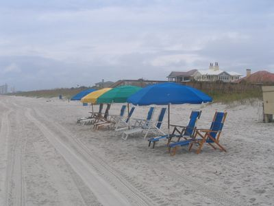 Umbrella & 2 beach chairs included!  Set up and taken down by the lifeguard.