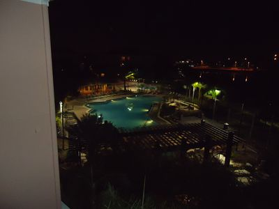 Your night time view of the pool from the lanai.