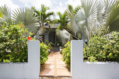 Bright, floral, welcoming front entrance.