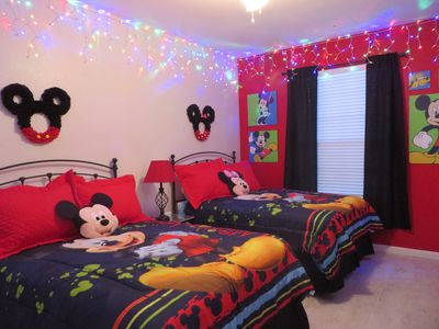 Fun Mickey room with bright colors and two full beds to sleep up to four.