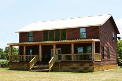 Rear features HUGE covered deck that faces Toledo Bend Reservoir.