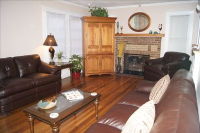 Living room has sleep sofa, fireplace and TV in armoire.