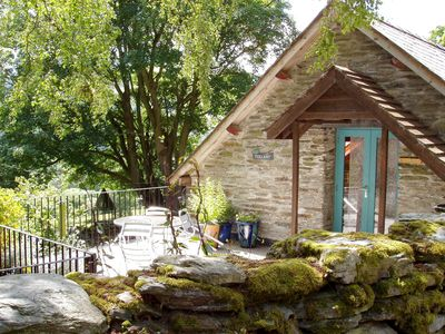 Photo for This first floor barn conversion features sheltered roof garden with hot tub and traditional farmlan