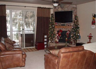 Living room with 46 inch LCD. Notice the spa on the deck!  2 Christmas trees!