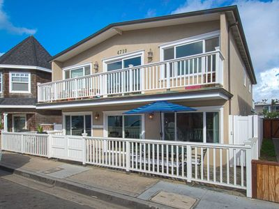 Photo for Create great memories in this lovely updated lower unit just steps to the sand.
