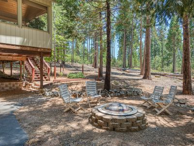 Photo for NEW LISTING! Secluded woodland home w/ shared amenities, fireplace & deck!