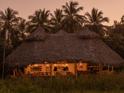 Photo for Regenerative tropical lodge with chic details , steps away from the beach.