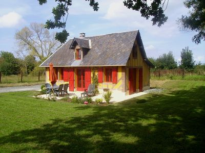 Photo for Cottage in the quiet of the countryside of the Pays d'Auge.