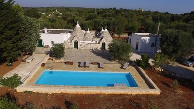 Photo for Trulli with swimming pool among olive trees
